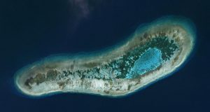 Vietnamese-held Ladd Reef, in the Spratly Island group in the South China Sea, July 19, 2016, in this Planet Labs handout photo received by Reuters on December 6, 2016. An outpost that houses a Vietnamese garrison can be seen on the central northern part of the reef, accessed by two small perpendicular channels. To match Exclusive SOUTHCHINASEA-VIETNAM/    Trevor Hammond/Planet Labs/Handout via REUTERS            ATTENTION EDITORS - THIS IMAGE HAS BEEN SUPPLIED BY A THIRD PARTY. FOR EDITORIAL USE ONLY. NO RESALES. NO ARCHIVES